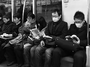 Photo: Readers  It's a sign of how digitized the times are when the sight of a few people reading actual paper books makes me do a double-take.  I've joined the digital revolution myself - I never ever go anywhere without my Kindle. In fact, given the choice between my camera or my Kindle... the Kindle would win. However, I still have a huge soft spot for real paper books. If I could, I'd live in a library! Also, real books never run out of battery. ;-)  So, I get unaccountably happy when I see people reading actual books, and want to go up and give them a big ol' high five :)  Off to bed to fight the onset of a cold, have a good weekend everyone!  #creative366project