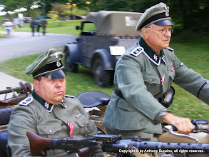 """Photo: Asked why he chose to portray a German soldier, a re-enactor said, """"The good guys need somebody to shoot."""""""