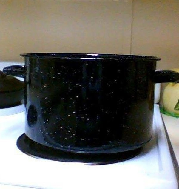 While the mixture is boiling; butter a large pot or bowl to mix in.