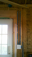 Photo: Put plastic conduit over some of the 12/2 wire for protection since the walls aren't going to be drywalled and closed in.
