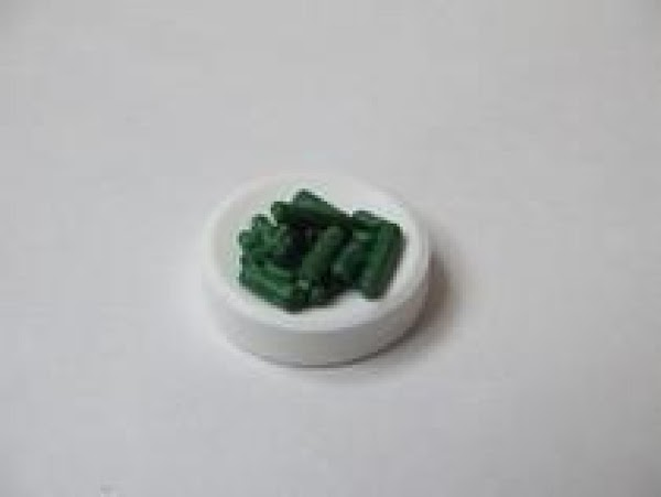 For the green beans:  1.  Secure green jimmie sprinkles on jumbo Smartie candy with...