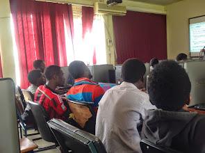Photo: Developers listen to facilitator's instruction