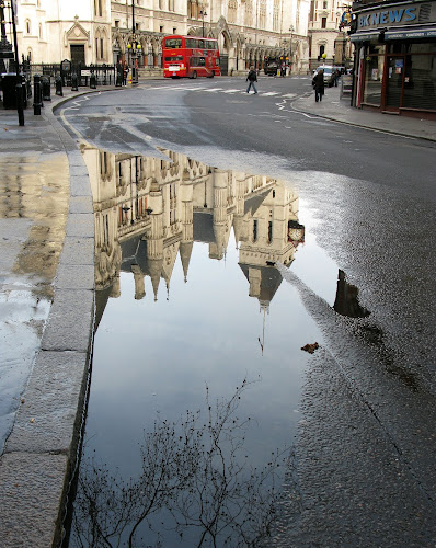 The Law Courts, Strand, London by Michael Summers - Buildings & Architecture Public & Historical ( reflection, law courts, london, strand, puddle )