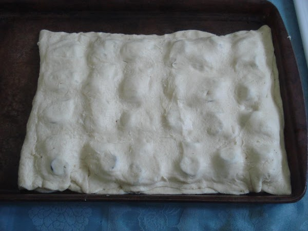 Unroll remaining dough directly over filling, matching edges and shaping  to fit. Press firmly...