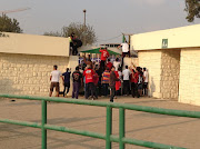 Al Ahly fans are senn climbing over walls to enter the match venue for the 2013 Caf Champions League second leg final against Orlando Pirates.