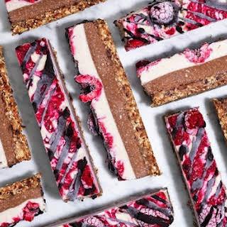 Vegan Raspberry And Cacao Cheesecake Bars.