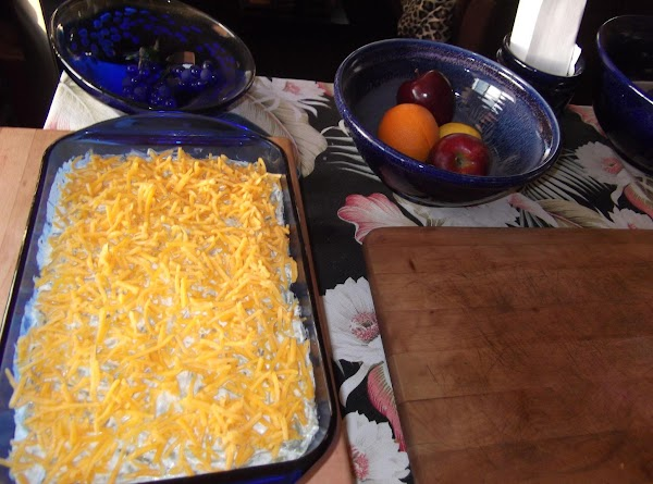Pour into greased casserole.  Sprinkle with grated cheese.  Melt remaining 1/2 stick...