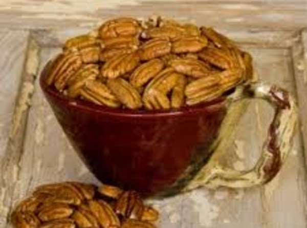 Dip your pecan halves into the mix and put on your cookie sheet leave...