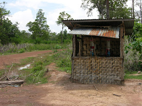 Photo: Local petrol station as we went further off the track in south east Laos