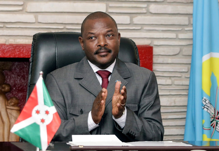 Burundian President Pierre Nkurunziza claps after signing the new constitution at the presidential palace in Gitega Province, Burundi, on June 7 2018. File Picture: REUTERS/EVRARD NGENDAKUMANA