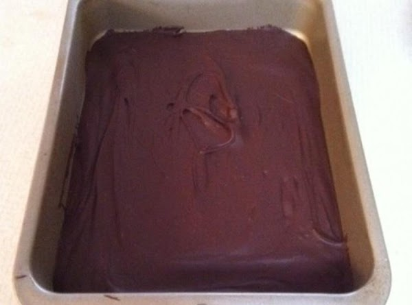 Spread melted chocolate in bottom of a 8x8 inch pan. Let harden (I put...