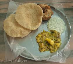 Photo: Breakfast In Pondicherry Tamil Nadu Puri, Medu Vada, Sambar and Potatoe Curry