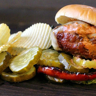 Buffalo Bill Burgers with Smoky BBQ Cream Sauce and Caramelized Red Pepper Rings.