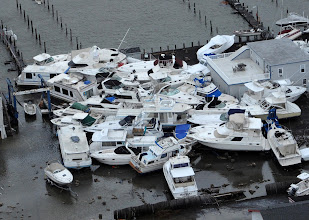 Photo: Boats cluster together at a marina in Brant Beach, on Long Beach Island on the New Jersey shore, on Tuesday, Oct. 30, 2012, a day after superstorm Sandy blew across the New Jersey barrier islands. (AP Photo/Philadelphia Inquirer, Clem Murray)
