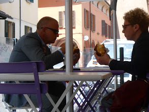 Photo: ... but we also enjoyed the people watching. This couple was having their lunch, a different kind of ice cream sandwiches than we are used to in the US. A large brioche roll stuffed with several scoops of gelato. Yeah, lunch.