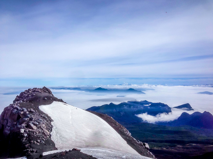 the glacier at the top of the volcan villarrica and the volcanoes and view from the summit of the volcan