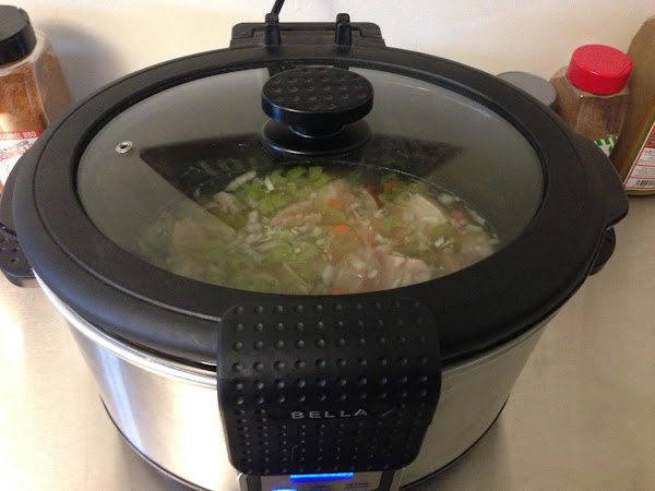 Add your ham shank, split peas and water to the crock pot.