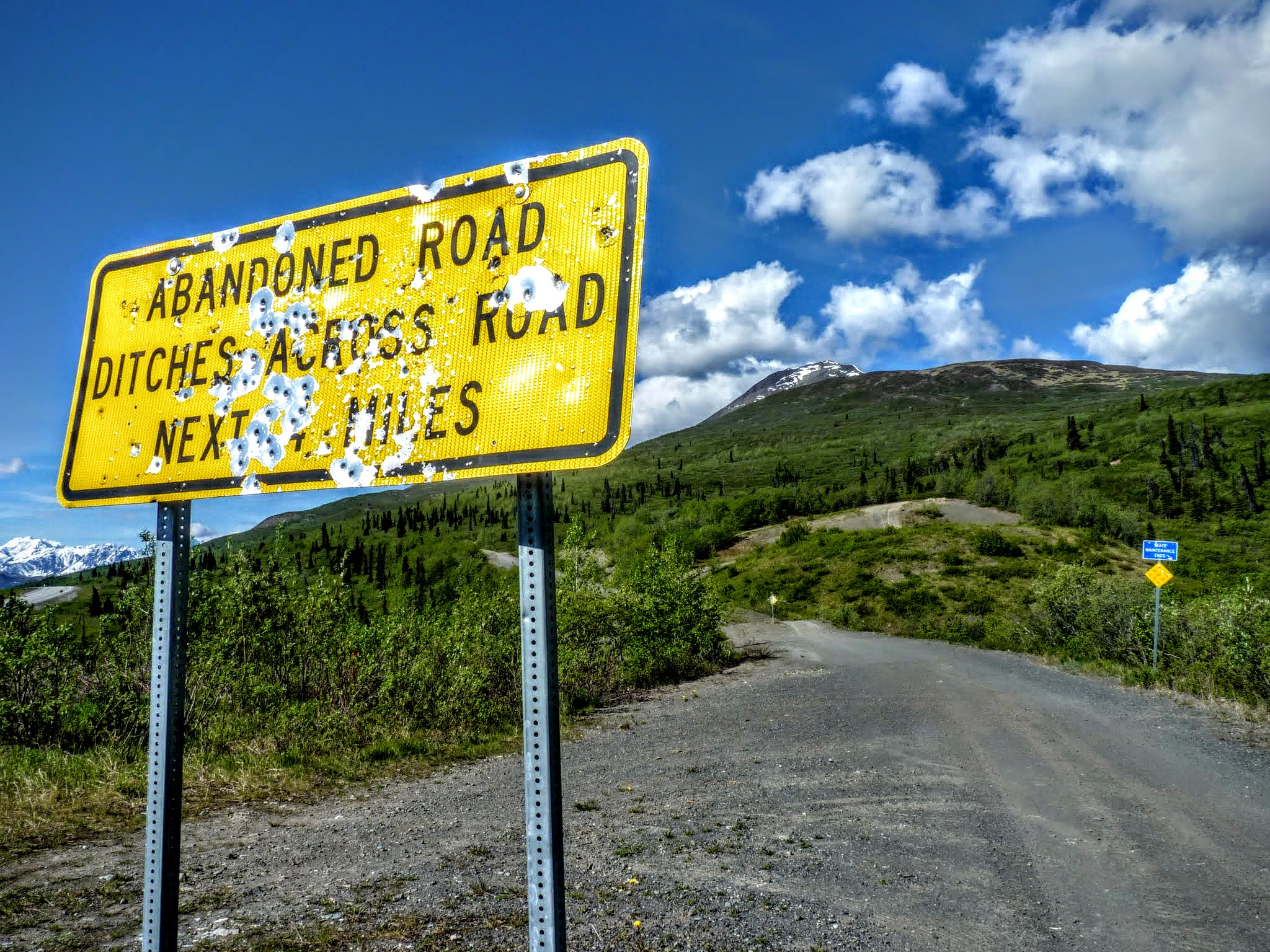 Photo: As usual, this Alaskan sign has taken a fair number of hits.