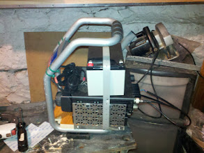 Photo: Side view with battery, charger, and radios in place.