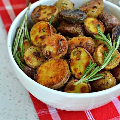 "Roasted Rosemary Potatoes ""Simple yet elegant these delectable Roasted Rosemary Potatoes make..."