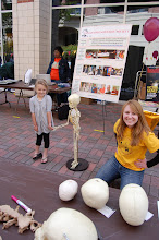 Photo: Dr. Kathryn O'Donnell Miyar at the Kleiman Plaza science day making a new friend. Dr. Miyar is woking on a post-doc in Scientific Computing and is also employed by the Southeast Archeological Center, National Park Service, Innovation, Park, Tallahassee.