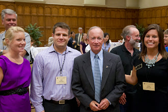 Photo: Purdue University President Mitch Daniels with DVM students at the Medicine Mixer and Auction.