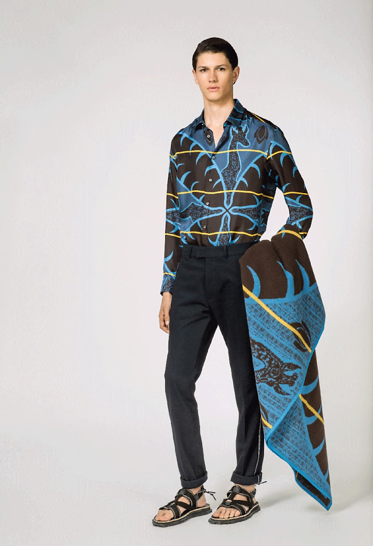 "Louis Vuitton's Giraffe Printed Classic Shirt ""features an abstract African blanket and giraffe design,"" according to the luxury brand's website. Here, it's paired with their Basotho Plaid throw."