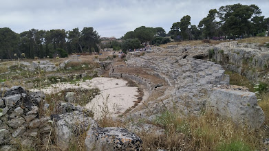 Photo: Chris and I spent our first full day in Sicily taking a day trip to Siracusa (aka Syracuse) to see the Greek and Roman ruins there and the island of Ortygia, which is the main commercial center of the place.   We parked our car, found the ruins, and started by visiting the Roman amphitheater, pictured above.