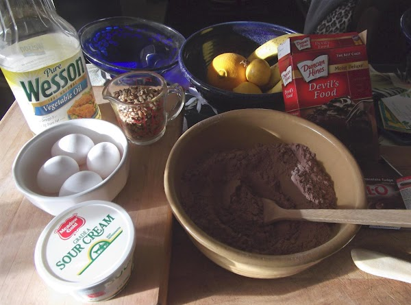 Mix together cake and pudding mixes; add eggs, oil, sour cream and water, stirring...