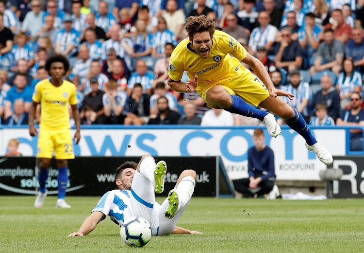 Huddersfield Town's Christopher Schindler fouls Chelsea's Marcos Alonso and a penalty is awarded during a Premier League match at the John Smith's Stadium on August 11, 2018. Chelsea won 3-0.