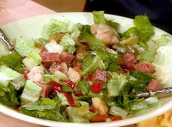 Make salad with ingredients of choice, sprinkle with parm, basil and vinagerete.