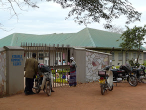 Photo: Some patients come from far away and hire a boda-boda motorbike to get to the clinic.