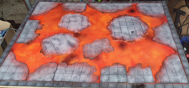 Lava coloured board, with a mixture of broken cork made to look like dungeon tiles, and plastic ones.   There is variation in the grey colours across the 3 materials.