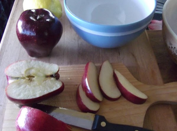 Chop apples into small chunks and place into bowl. Sprinkle with lemon juice.Add sugar,...