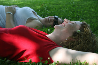 Photo: M and A giggling under the trees