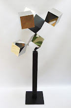 Photo: 30 REFLECTIONS AND A VOID - 58H X 26W X 24D Polished Stainless Steel, Painted Mild Steel, Front View