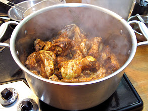 Photo: browning the marinated chicken pieces in the butter and oil remaining from frying shallots