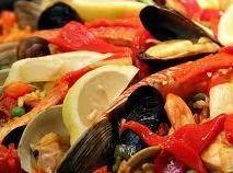 Discard any mussels and clams that have failed to open.   Serve the paella straight from...