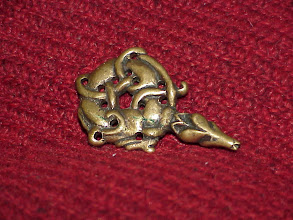 Photo: A bronze Later Anglo-Saxon dragon headed book mount from Sedgeford in Norfolk that had been altered and then re-used as a pendant. (Dear viewer, it shouldn't have precise round holes drilled in it - not my fault...) About 50mm in length.