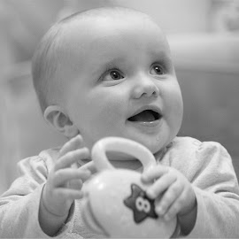 Great Niece by SJ Burnell - Babies & Children Babies ( baby girl, baby face, baby, black and white, baby playing )