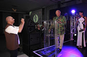 FILE IMAGE: November 02, 2015. Two of the six Lifetime Achievement Awards recipients. Photographer Omar Badsha (Visual Arts) takes a snap with his cellphone of Don Mattera (Literature) during the latters acceptance speech. The 18th Annual Arts and Culture Trust Awards. Held at the Maslow Hotel, Sandton.