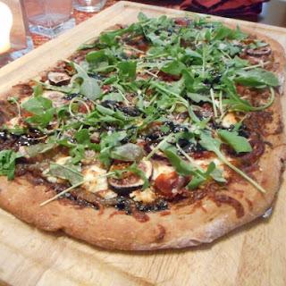 Fig, Goat Cheese, Prosciutto, and Arugula Pizza.