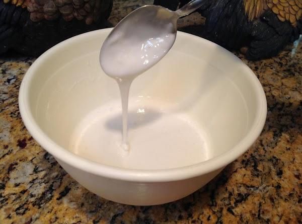 Put powdered sugar in bowl and add milk.  Stir to blend.
