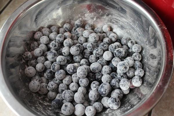 Coating blueberries in flour.