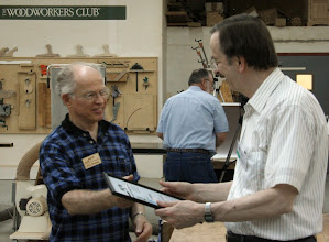 Photo: Gary Guenther receives Certificate of Appreciation from Phil Brown.