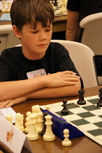 Photo: Ethan Allison, Bright Stars, Section D eyes his contemplates what to do with his rook on the nice open c-file. Ethan has been a strong presence in USCF events all over the state, but this was his first NWSRS event. He debuts at 1433.