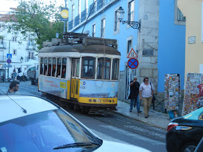 Photo: Tram going through the Alfama District. The tram is picturesque but it was always packed with tourists and super slow, like our cable cars. So we didn't bother taking it (also like our cable cars).