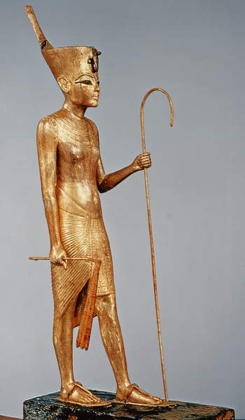 Image of Statuette of the king wearing the red crown of the north, from the tomb of Tutankhamun (c.1370-52 BC) New Kingdom (gilded wood), Egyptian 18th Dynasty (c.1567-1320 BC) / Egyptian, Egyptian National Museum, Cairo, Egypt, height: 75 cms, © Bridgeman Images