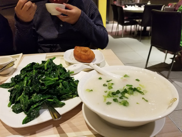 Stir-fried vegetables, congee and Chinese donut