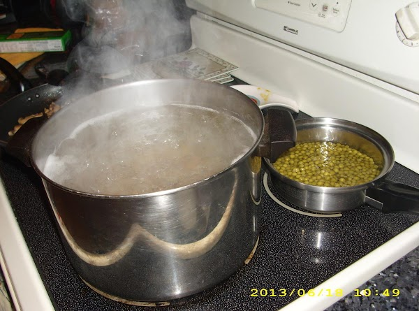 Bring a large pot and a small pot of salted water to a boil....